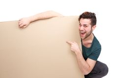 Man smiling pointing finger to empty space Stock Images