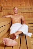 Man smiling in sauna Stock Photo