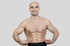 Man smiling showing abs. Stock Photography