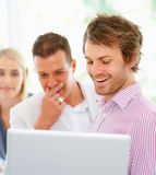 Man smiling while showing colleagues proposal Royalty Free Stock Photo