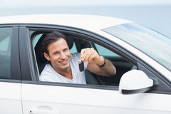 Man smiling and showing key Stock Photography