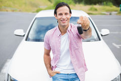 Man smiling and showing key Stock Photos