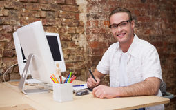 Man smiling while sitting and taking notes Stock Photo