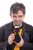 Man smiling with a SLR photo camera Royalty Free Stock Photography