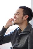 Man smiling and talking on cellphone Royalty Free Stock Photo