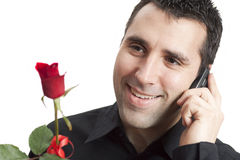 Man Smiling, Talking On Cellphone, Holding Red Ros Royalty Free Stock Photos