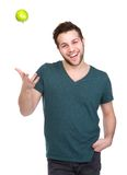 Man smiling and throwing apple up Stock Photo