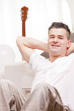 Man smiling to camera relaxing in his living room Royalty Free Stock Image