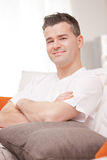 Man smiling to camera relaxing in his living room Royalty Free Stock Photography