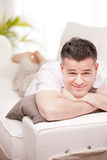 Man smiling to camera relaxing in his living room Royalty Free Stock Photos