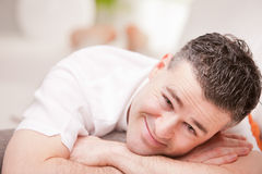 Man smiling to camera relaxing in his living room Royalty Free Stock Photo