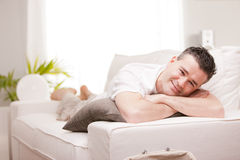 Man smiling to camera relaxing in his living room Stock Images