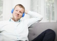 Man smiling to himself as he listens to music Stock Image