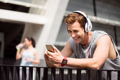Man smiling and using headset after training Royalty Free Stock Images