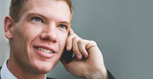 Man smiling using phone smiling with copy space royalty free stock images