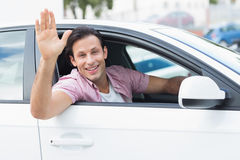 Man smiling and waving Stock Photography
