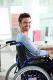 Man smiling in wheelchair Royalty Free Stock Photography