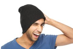 Man smiling and winking. Close up portrait of a man smiling and winking with black hat Royalty Free Stock Photos