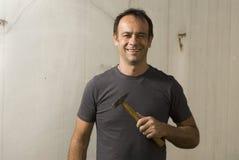 Man Smiling With Hammer - Horizontal Royalty Free Stock Photo