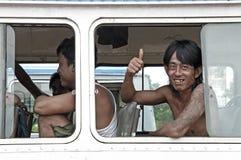 Man smiling on yangon myanmar bus. Burma royalty free stock photography