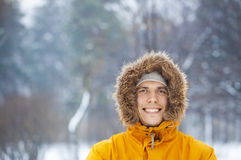 Man smilling in winter park. Man in bright clothes smilling in winter park Stock Photos