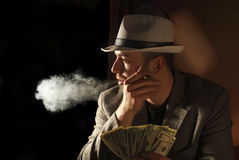 Man smoke and hold few dollars in his hand Royalty Free Stock Photo