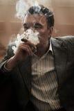 Man smoke at home Royalty Free Stock Photo