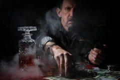 Man smoke pipe and play poker. Old man smoke pipe and play poker stock photos