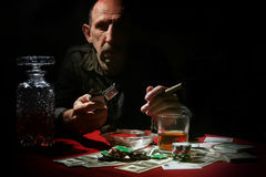 Man smoke pipe and play poker. Old man smoke pipe and play poker stock photography