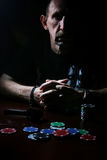 Man smoke pipe and play poker. Portrait of a person in a particular situation during the day stock images