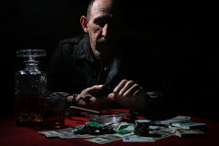 Man smoke pipe and play poker. Textured very old man with a straight face in the form of a player from the ranch royalty free stock photo