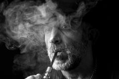 Man in the smoke portrait Stock Images