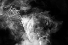 Man in the smoke Stock Photo