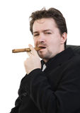 Man smokes cigar Stock Images