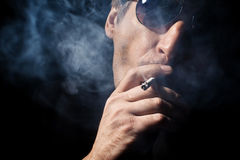 The man smokes a cigaret Stock Image