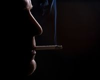 The man smokes a cigarette Royalty Free Stock Photography