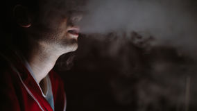 Man smokes in the dark Royalty Free Stock Photo