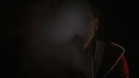 Man smokes in the dark Royalty Free Stock Image