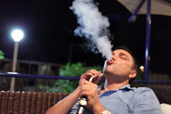 Man smokes hookah Royalty Free Stock Photography