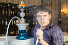 Man smokes a hookah Stock Photo
