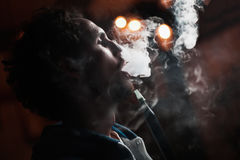 Man smokes  hookah Royalty Free Stock Images