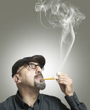 The man smokes a pipe Royalty Free Stock Image