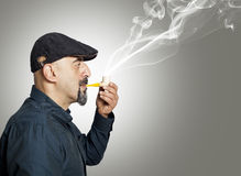 The man smokes a pipe Stock Images