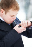 Man smokes pipe Royalty Free Stock Photography