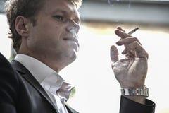 Young man smoking Stock Photos
