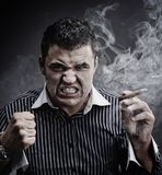 Man smoking cigar Stock Images