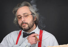 Man smoking cigar Stock Image