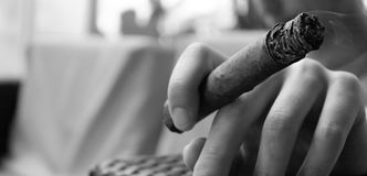 The Man is Smoking a Cigar. Copy Space Royalty Free Stock Photography