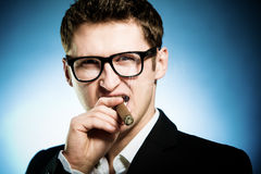 Man smoking cigar Stock Photography