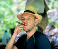 Man smoking cigar Stock Photo